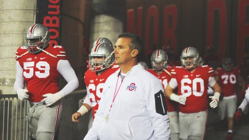 Urban Meyer salutes the vets.