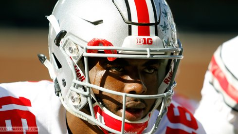 J.T. Barrett tallied nearly 225 yards of total offense against Illinois in his return from suspension.