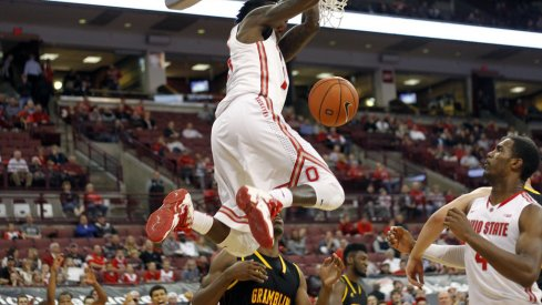Kam Williams slams home a dunk against Grambling.