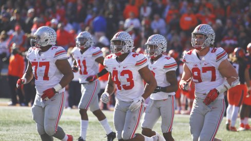 Ohio State's defense jogs off the field against Illinois.