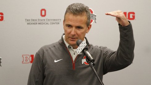 Urban Meyer showing how much he loves fielding calls.