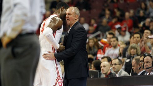 Thad Matta greets Daniel Giddens as he walks off the floor.