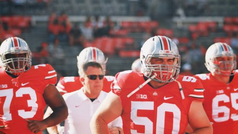 Jacoby Boren leads Ohio State onto the field.