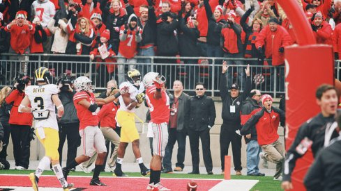 Darron Lee celebrates a 2014 Michigan win with the pulsating heart of Michigan.