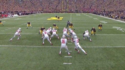 Ezekiel Elliott breaks Michigan up the middle.