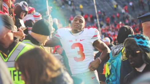 Michael Thomas shakes hands with the fans after Ohio State's 42-13 rout of Michigan.