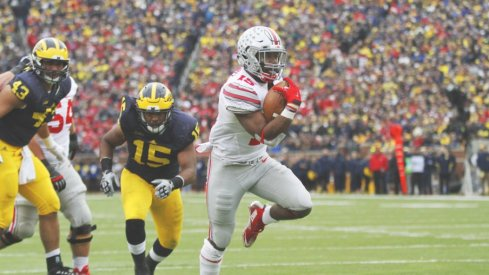 Ezekiel Elliott ran around and through Michigan's defense with 214 yards and two scores.