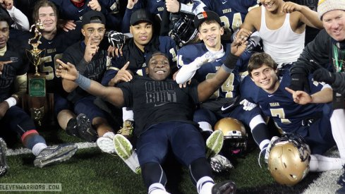 Todd Sibley and Akron Hoban celebrate their first state title.