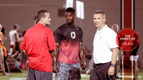 Tim Beck, Tristen Wallace and Urban Meyer at Ohio State in June.