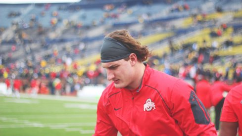 Joey Bosa warms up for the Michigan game.