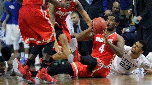 Daniel Giddens scrambles for a loose ball against Kentucky.