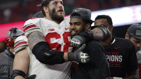 Taylor Decker hugs Ezekiel Elliott after Ohio State's Fiesta Bowl win.