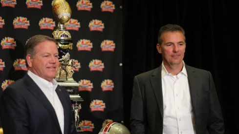 Brian Kelly, Urban Meyer pose with Fiesta Bowl trophy.