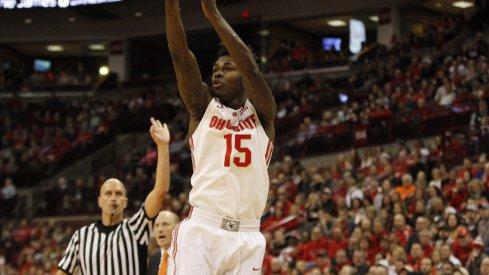 Kam Williams hoists a jumper against Illinois.