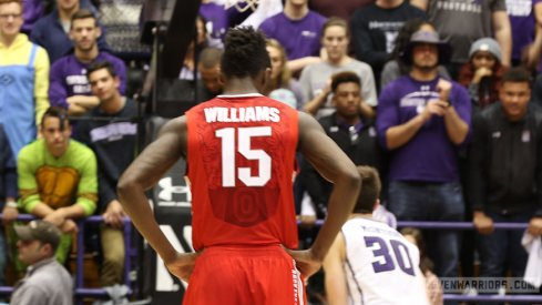 Kam Williams looks on as Northwestern shoots a free throw Wednesday night.