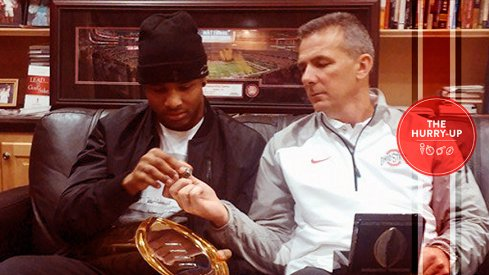 Keandre Jones and Urban Meyer examine some Buckeye hardware.