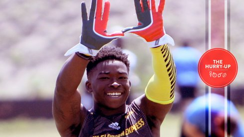"Sam Bruce throwing up ""The U"" at a 7-on-7 tournament."