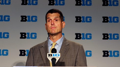 Jim Harbaugh is taking roster management to a whole new level in the Big Ten.