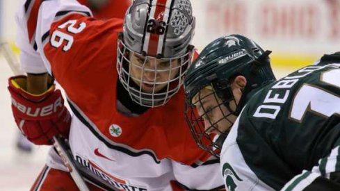 Ohio State's Mason Jobst squares off against Michigan State's Matt DeBlouw.