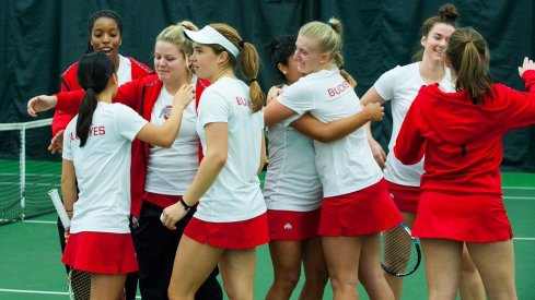 Women's tennis team celebrates victory over rival Michigan