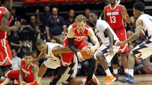 Mickey Mitchell comes up with a loose ball in OT against the Illini.