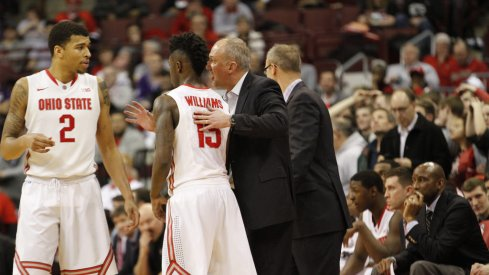 Thad Matta gives instructions to Marc Loving and Kam Williams.