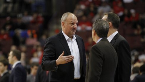 Thad Matta talks to the Northwestern staff.