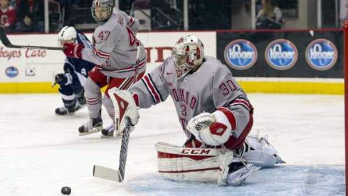 Josh Healey looks on as Christian Frey makes a save for Ohio State against Penn State