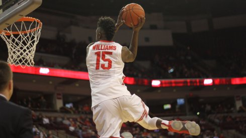 Kam Williams skies for a pregame dunk.