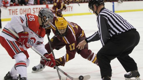 Ohio State's Mason Jobst faces off against Minnesota's Tommy Novak
