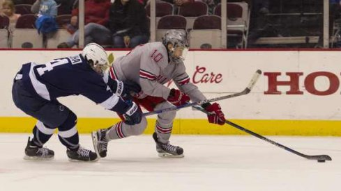 Ohio State's John Wiitala protects the puck from Luke Juha of Penn State