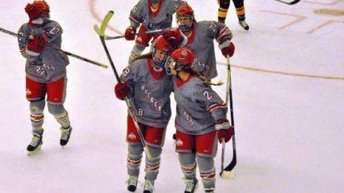 Ohio State women's hockey seniors Kendall Curtis and Cara Zubko skate off the ice.