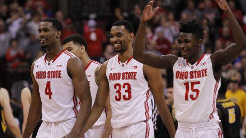 Daniel Giddens, Keita Bates-Diop and Kam Williams celebrate win over Iowa.