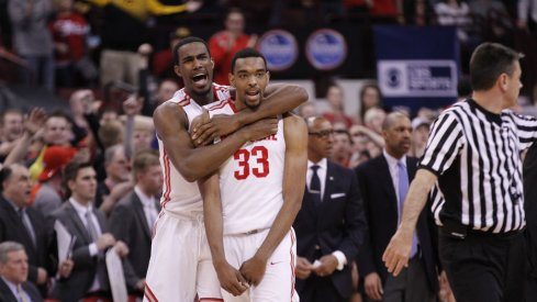 Daniel Giddens celebrates with Keita Bates-Diop after Ohio State beats Iowa.