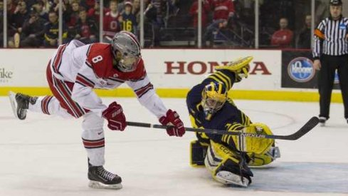 Ohio State forward Dakota Joshua wins the shootout with a goal against Michigan goalie Steve Racine.