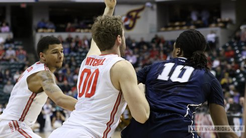 Marc Loving and Mickey Mitchell apply defensive pressure against Penn State