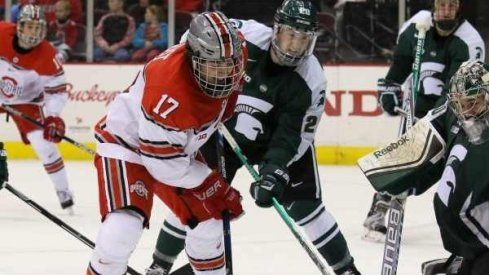 Ohio State forward David Gust goes to the net against Michigan State.
