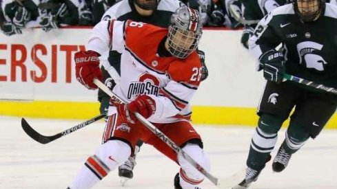 Ohio State forward Mason Jobst controls the puck against the Michigan State Spartans.