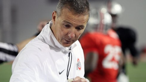 Urban Meyer addresses his team during spring practice.