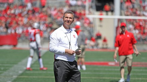Urban Meyer met reporters briefly Wednesday at the WHAC.
