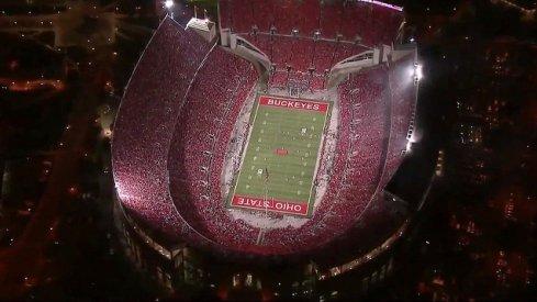 Ohio Stadium under the lights look back.