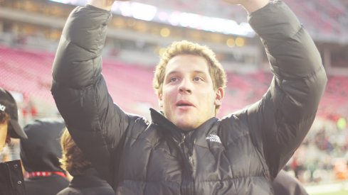 Nick Bosa plays to the crowd pregame at Ohio State in 2015.