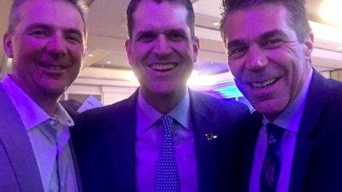 Jim Harbaugh and Urban Meyer posed for a selfie Friday night with Chris Fowler.