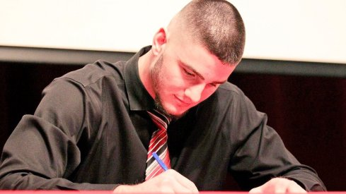 Luke Farrell signs his letter of intent