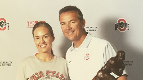Kristin Conrad and Urban Meyer pose for a photo at the Ohio State Football Women's Clinic