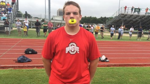 Jack McCollum shows up wearing Ohio State shirt to a Michigan camp.