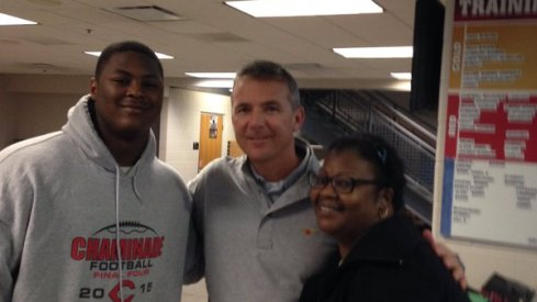 Urban Meyer with Trevor Trout and his mother.