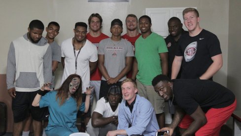 Ohio State's running backs had some fun Tuesday night running from zombies.