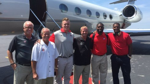 Ohio State captains and old men board flight to Chicago en route to Chicago.