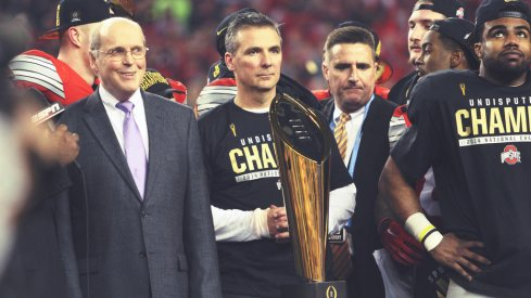 Urban Meyer and the CFP trophy.